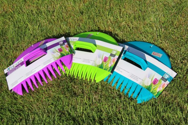 three hand rakes in different colors